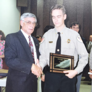 Shelby County Sheriff AC Gilless recognizing Rhea Tyer as the SCSD's 1993 Graduating Class Honor Graduate